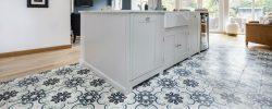 Encaustic pattern tiles in kitchen, surrounding kitchen island
