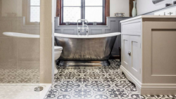 Bathroom with rolltop bath and encaustic cement tile flooring