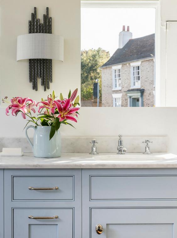 Brass handles on shaker inspired kitchen units