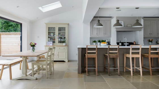 Open plan kitchen with limestone flooring